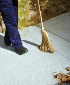 Sweeper, municipal worker cleaning