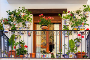 jpg20151016130813252538 Traditional European Balcony with colorful flowers and flowerpots